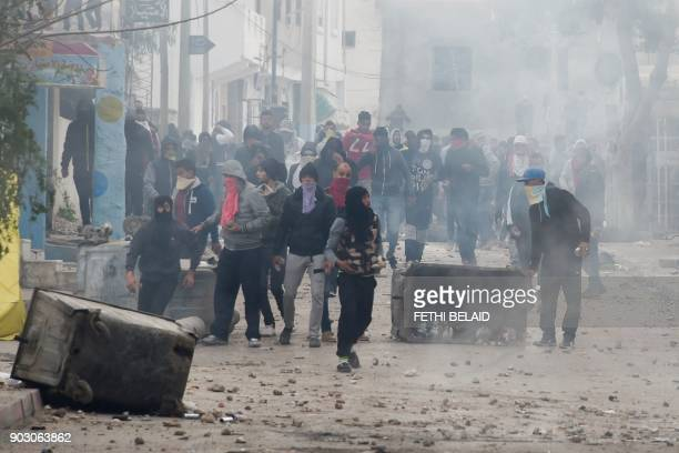TOPSHOT Tunisian protesters clash with security forces in the town of Tebourba on January 9 following the funeral of a man who was killed the...