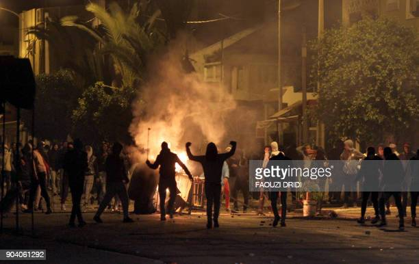 TOPSHOT Tunisian protesters take to the streets in Siliana some 130 kms south of Tunis late on January 11 2018 More than 200 people have been...