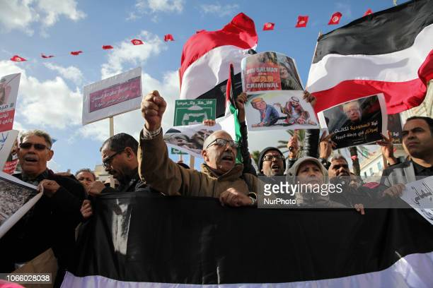 Tunisian protesters wave flags of Yemen and raise portraits of Donald Trump which read in Arabic 'without Saudi Arabia Israel would have been in...
