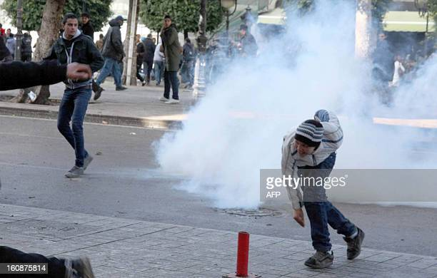 Tunisian protestors clash with security forces outside the Interior Ministry in Tunis on February 7 2013 following a demonstration against the...
