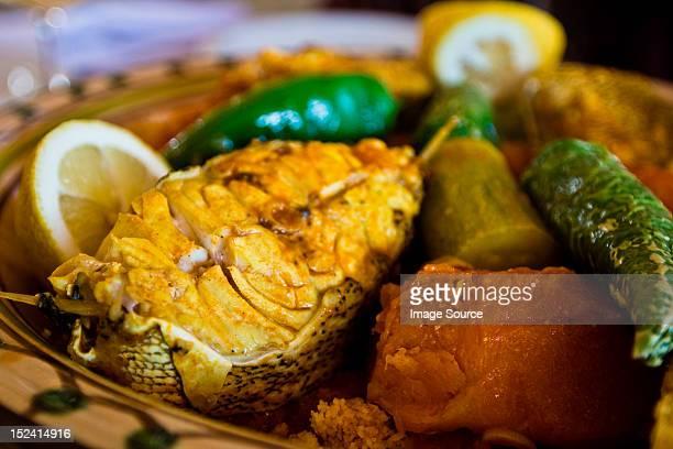 Tunisian restaurant dish of grouper with vegetables, Djerba