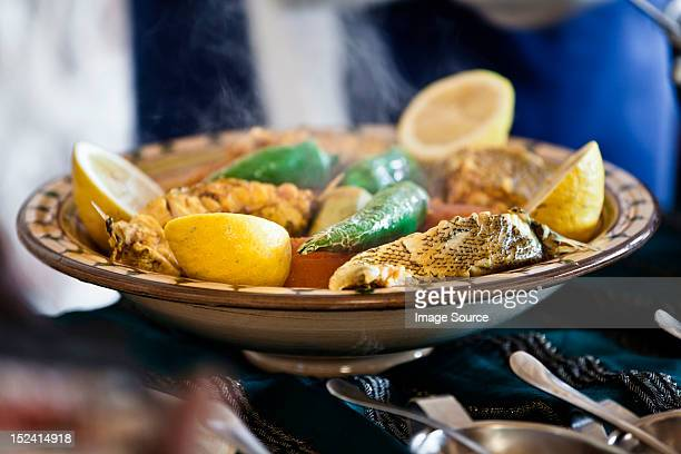 tunisian restaurant dish of grouper with vegetables, djerba - djerba stock pictures, royalty-free photos & images