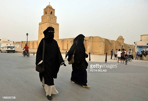 Tunisian salafi women walk in front of Okba Ibn Nafaa mosque in the city of Kairouan on May 18 2013 Security forces deployed in numbers after...
