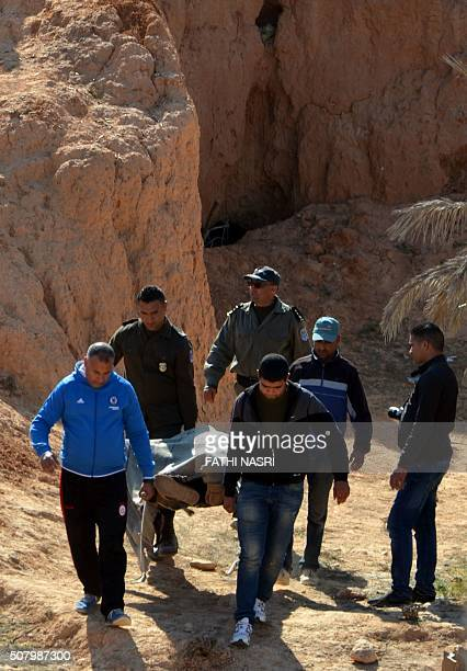Tunisian security forces carry the body of a suspected jihadist who was killed during a security sweep in the mountainous Tounine area some 30...