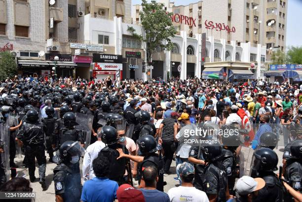 Tunisian security forces face off with protesters during a rally against Ennahdha party and the government at the Parliament. Supreme Council for...