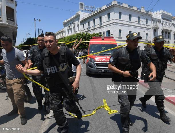 Tunisian security forces gather at the site of an attack in the Tunisian capital's main avenue Habib Bourguiba on June 27 2019 A suicide attack...