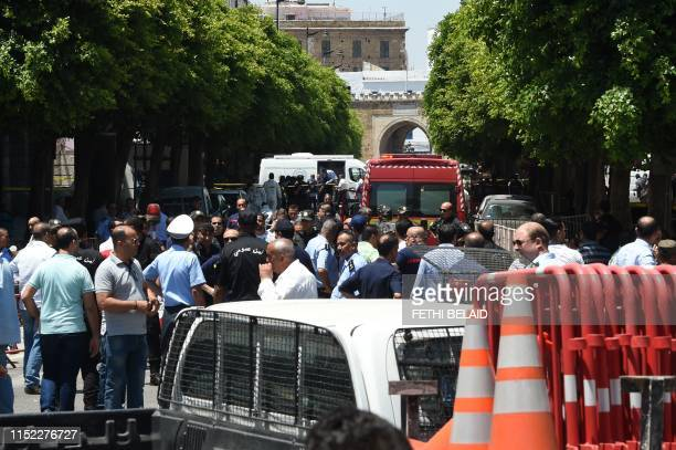 Tunisian security forces gather at the site of an attack in the Tunisian capital's main avenue Habib Bourguiba on June 27 2019 Two suicide bombers...