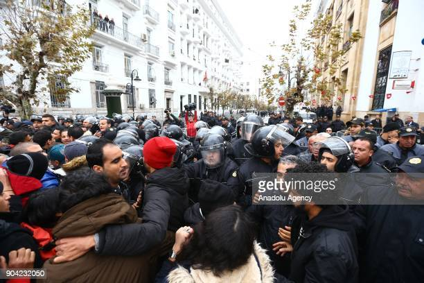 Tunisian security forces intervene demonstrators during a protest against new budget law and price hikes as they march to the governorship building...