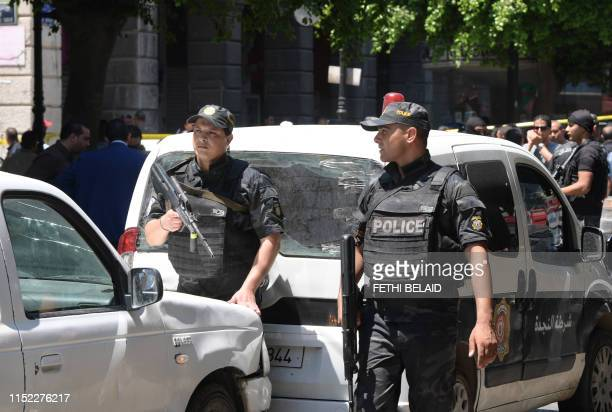 Tunisian security forces stand guard at the site of an attack in the Tunisian capital's main avenue Habib Bourguiba on June 27 2019 A suicide attack...