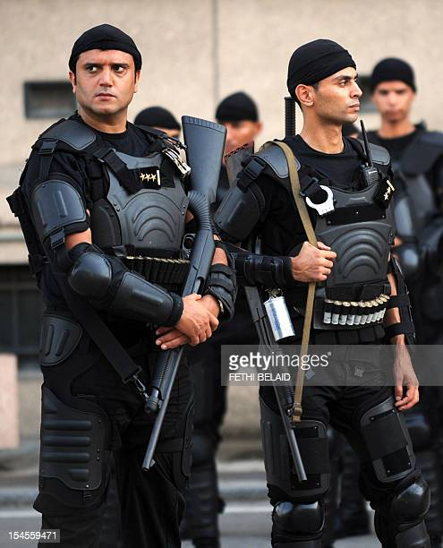 Tunisian security forces stand guard outside the interior ministry in the Habib Bourguiba Avenue in Tunis on October 22 2012 as more than 1000...
