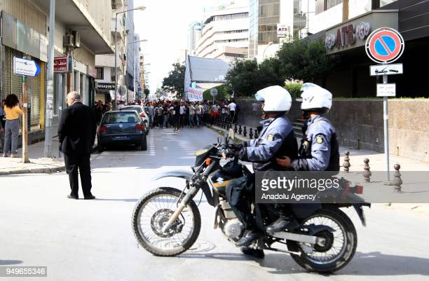 Tunisian security forces take security measures as supporters of Football Club Africain stage a protest after the death of a supporter Omar Abidi as...