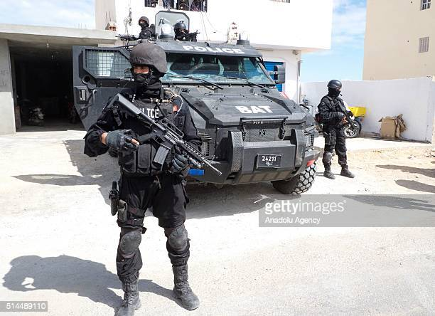 Tunisian security forces take security measures during the funeral ceremony of Tunisian soldiers who lost their lives during an antiterror operations...