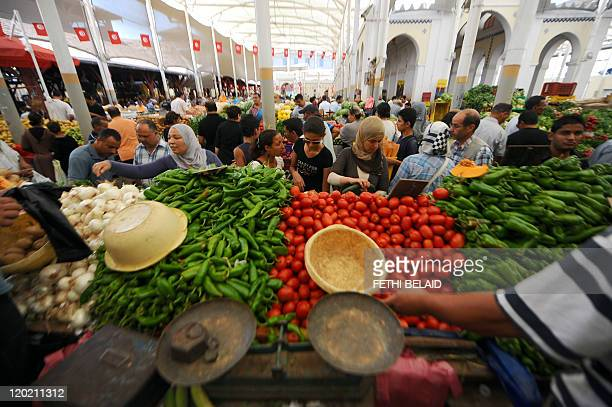 Tunisian shoppers browse vegetables displays on the first day of the Muslim holy fasting month of Ramadan at a central market in Tunis on August 1...