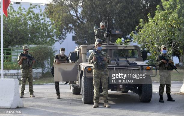 Tunisian soldiers cordon-off the Parliament in the capital Tunis on July 26 following a move by the President to suspend the country's parliament and...