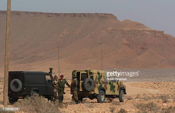 Tunisian soldiers stand watch near the DehibaWazin border post after an incursion by troops loyal to Libyan leader Muammar Ghaddafi in a failed bid...