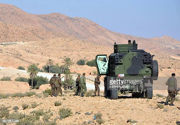 Tunisian soldiers take part in a security sweep in the mountainous Tounine area some 30 kilometres south of the coastal town of Gabes on February 2...
