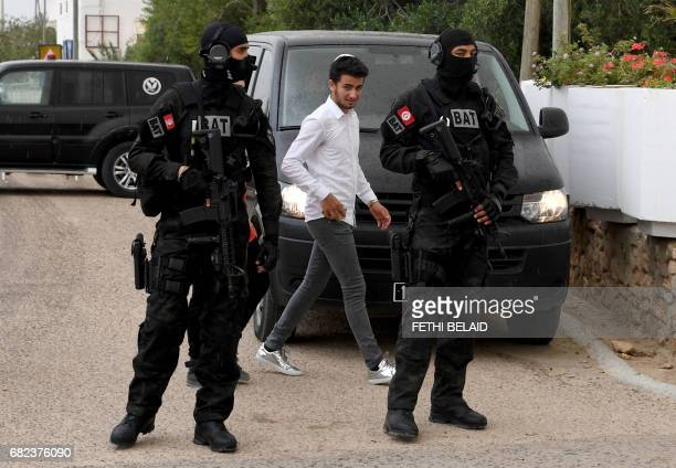 Tunisian special forces stand guard outside the Ghriba synagogue on the Tunisian resort island of Djerba on May 12 2017 during the first day of the...