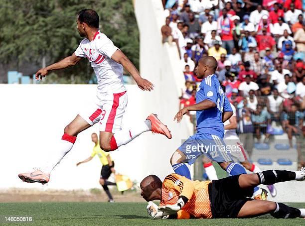 Tunisian striker Saber Khalifa jumps over Cape Verde's goalkeeper Ernesto Soares after scoring on June 9 2012 in Praia Stadium during the 2014 World...