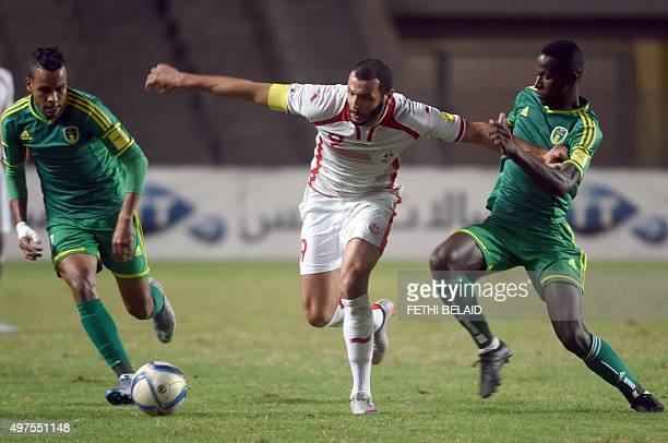 Tunisian striker Yassine Chikhaoui vies with Mauritanian players Dialo Guidleye and Abdoul Ba during their FIFA World Cup 2018 qualifying football...