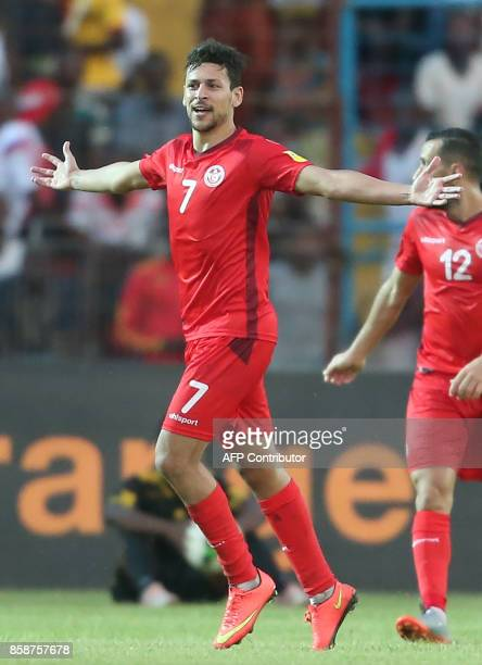 Tunisian striker Youssef Msekni celebrates after scoring against Guinea during the World Cup 2018 qualifying football match between Guinea and...