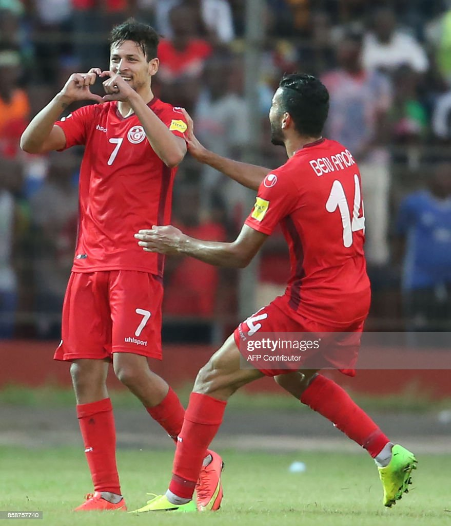 Tunisian striker Youssef Msekni (7) celebrates with Amine Ben Amor (14) after scoring against Guinea during the World Cup 2018 qualifying football match between Guinea and Tunisia on October 7, 2017 at the Conakry Stadium. PHOTO / STRINGER