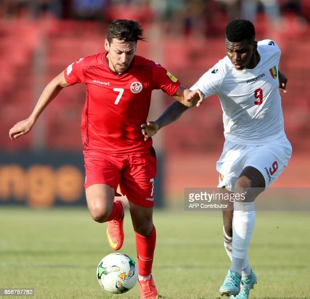 Tunisian striker Youssef Msekni vies with Guinea's player Soumah Seydouba during the World Cup 2018 qualifying football match between Guinea and...