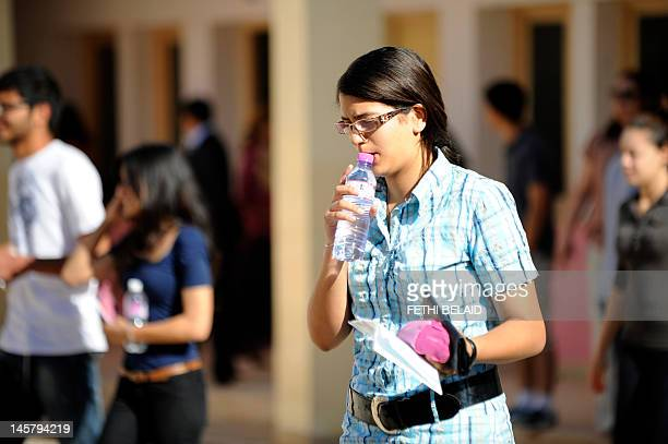 Tunisian student arrives to take the baccalaureat exam on June 6, 2012 at a high school in Tunis. Some 129 181 candidates registered for the main...