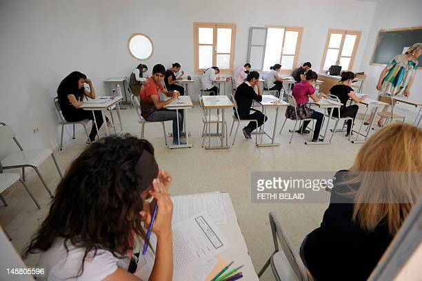 Tunisian student takes the baccalaureat exam on June 6, 2012 in Tunis. Some 129 181 candidates registered for the main session to be held...