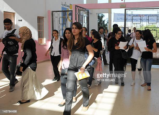 Tunisian students arrive to take the baccalaureat exam on June 6 2012 at a high school in Tunis Some 129 181 candidates registered for the main...