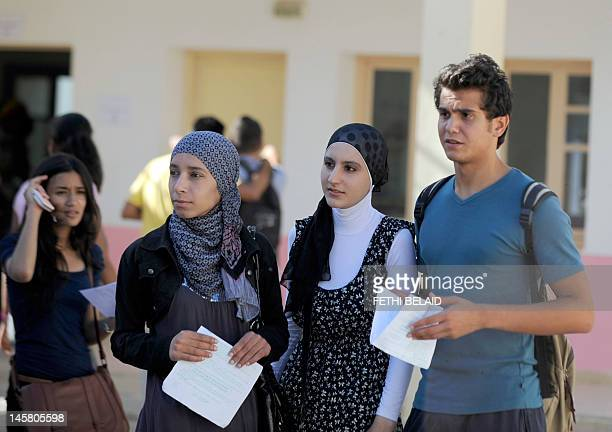 Tunisian students arrive to take the baccalaureat exam on June 6, 2012 at a high school in Tunis. Some 129 181 candidates registered for the main...