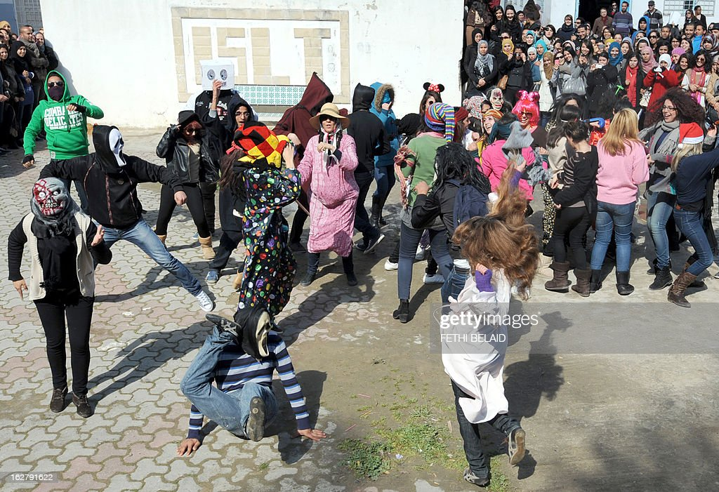 Tunisian students of the Bourguiba Language Institute in the El Khadra neighbourhood, a Salafist bastion of the capital Tunisia, perform the Internet craze, the 'Harlem Shake', outside their school on February 27, 2013. Salafist Muslims tried to prevent the filming of current global buzz dance but were driven off after coming to blows with students, an AFP correspondent said.