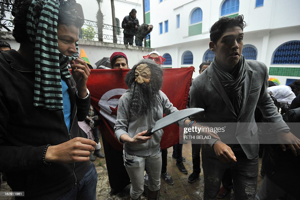 Tunisian students perform the internet video craze, the 'Harlem Shake', in front of the education ministry headqaurter on March 1, 2013. A few dozen braved the rain showing up in front of Tunisia's education ministry to perform a protest version of the 'Harlem Shake' dance craze which over the past week has infuriated ultra-conservative Muslims with their smoking, wild dancing and simulation of sexual acts, and has led to punch-ups with them and clashes with police.