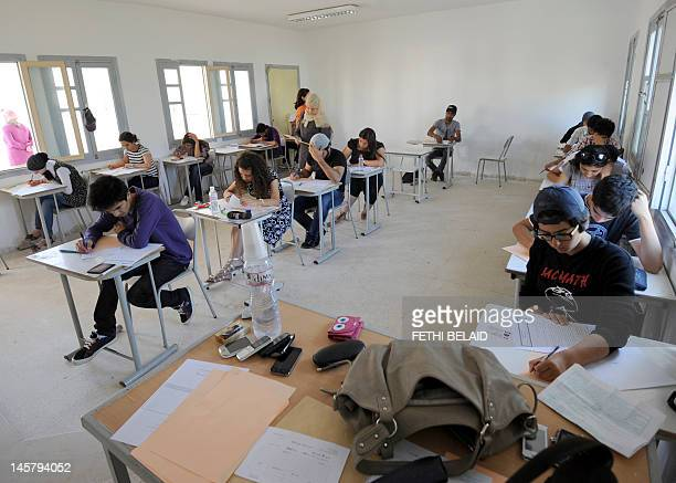 Tunisian students take the baccalaureat exam on June 6, 2012 in Tunis. Some 129 181 candidates registered for the main session of the baccalaureat...
