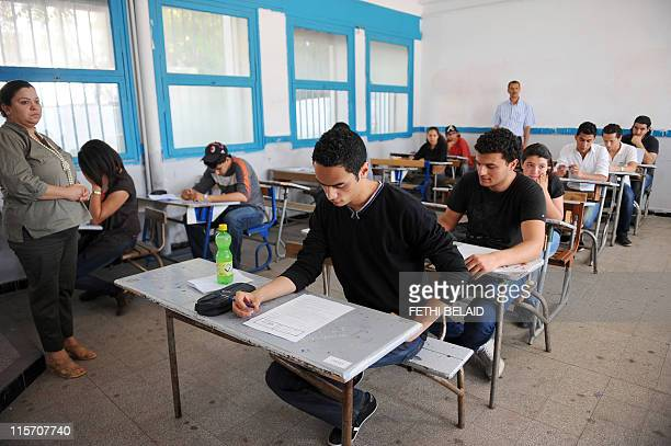 Tunisian students take the baccalaureat exam on June 9, 2011 in Tunis. Yesterday Tunisian Prime Minister Beji Caid Essebsi announced that the first...