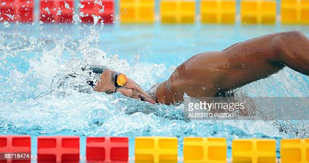 Tunisian swimmer Oussama Mellouli reacts after winning Men's 200m Individual medley final at the XVI Mediterranean Games in Pescara on June 27, 2009....