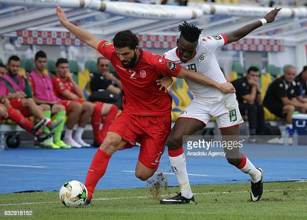 Tunisian Syam Ben Youssef vies with Bertrand Traore of Burkina Faso during the 2017 Africa Cup of Nations quarterfinal football match between Burkina...