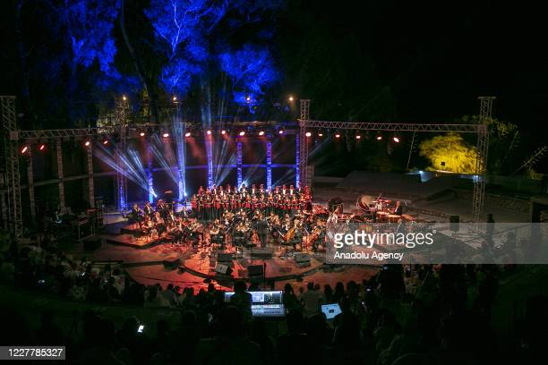 """Tunisian Symphony Orchestra performs on stage, marking the 63rd anniversary of the Tunisian Republic Day during the âHammamet Nights 2020"""", in..."""