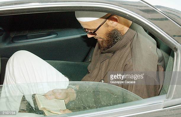 Tunisian terrorist Mohamed El Mahfoufi sits in a Guardia di Finanza car while reading the Koran in on June 24 2003 in Milan Italy At least six...