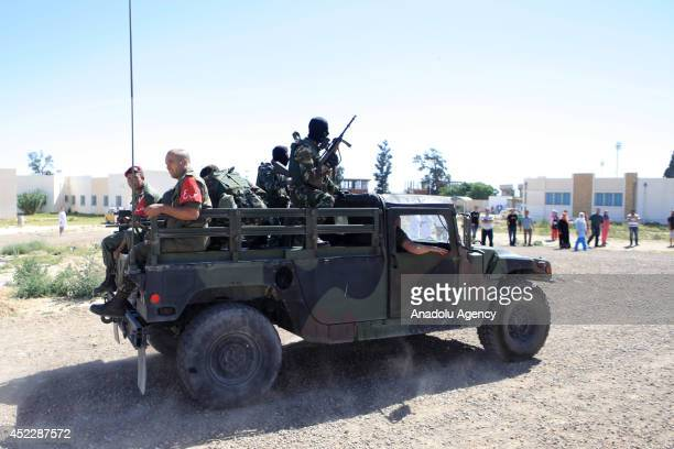Tunisian troops are seen around the hospital in Kassarine Tunisia on July 17 2014 Fourteen Tunisian military personnel were killed and 20 others...