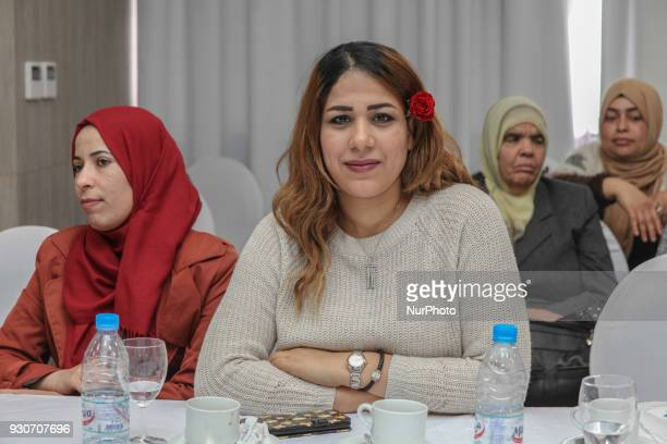 Tunisian woman attends a workshop on addressing the feminization of poverty guarantee of the economic and social rights of women equal inheritance...