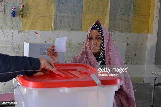 Tunisian woman casts her ballot in the second round of presidential elections at a polling station in Medenine Tunisia on December 21 2014 Nearly 53...