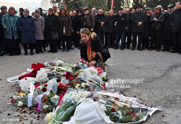 Tunisian woman lays flowers at the site of the assassination of prominent opposition figure Chokri Belaid as they mark the fifth anniversary of his...