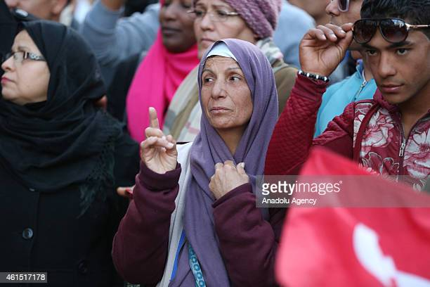 Tunisian woman reacts as military band performs at the Habib Bourguiba street in Tunis on January 132015 during the celebration of the 4th...