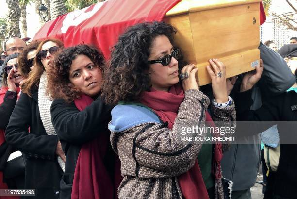 Tunisian women carry the coffin of human rights defender internetactivist and blogger Lina Ben Mhenni during her funeral procession on January 28...
