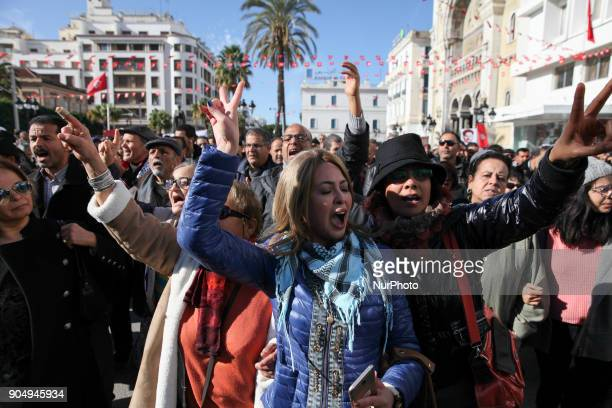 Tunisian women chant slogans and make victory sign as they took part in the celebration of the 7th anniversary of the Tunisian revolution the...