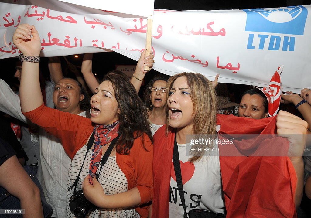 Tunisian women shout slogans during a protest calling for the respect of women's rights and other fundemental rights on August 13, 2012 in Tunis. Tunisian women are rising up against a proposed article in the new constitution being drafted by the National Constituent Assembly seen by many as an Islamist ploy to reverse the principle of gender equality that made Tunisia a beacon of modernity in the Arab world when it was introduced six decades ago.