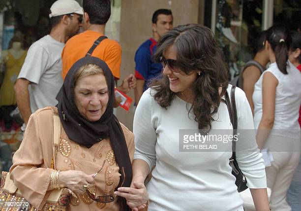 Tunisian women walk on French Avenue in Tunis 13 August 2007 National Day for Women in Tunisia Women in Tunisia who represent more than a quarter of...