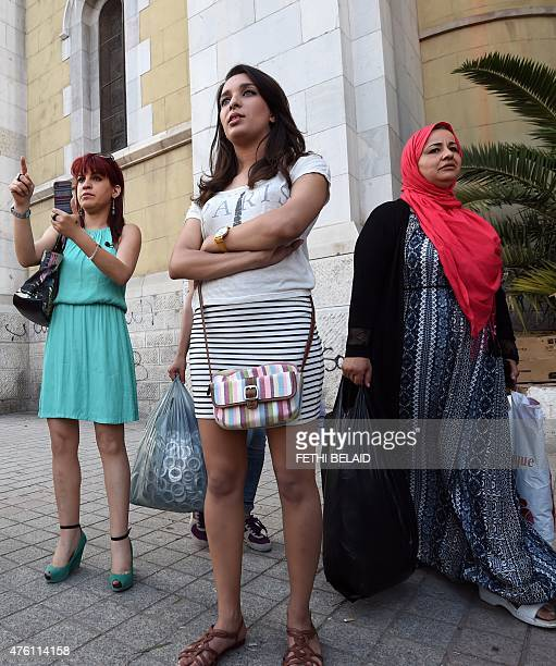 Tunisian women wear skirts during a demonstration titled the 'international day of the mini skirt' which aims to be a show of solidarity with...