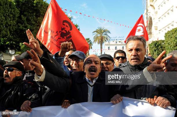 TOPSHOT Tunisian workers shout slogans against the government in front of the Tunisian General Labour Union headquarters in Tunis as they mark the...
