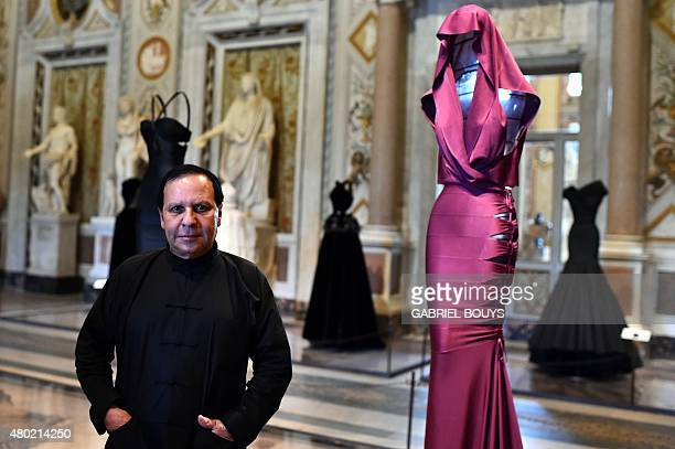 Tunisianborn Parisbased couturier Azzedine Alaia poses during the press preview of the exhibition ' Azzedine Alaia's soft sculpture' at the Galleria...